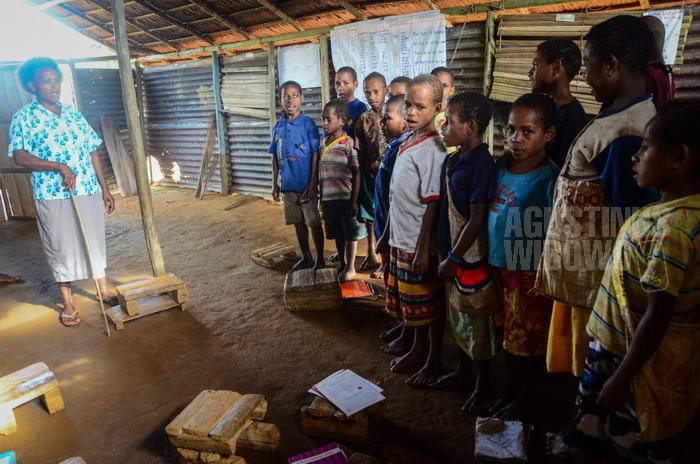 141024-png-digo-opm-refugee-school-1