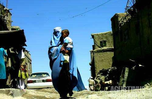 Woman in burqa, walking through the alleys of Deh Afghanan