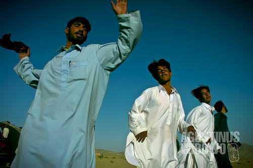 Pashtun men dance in full spirit in a wedding party