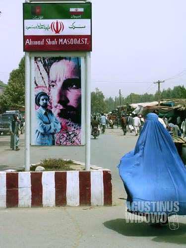 Taloqan: Ahmad Shah Massoud, Iranian flag, and burqa