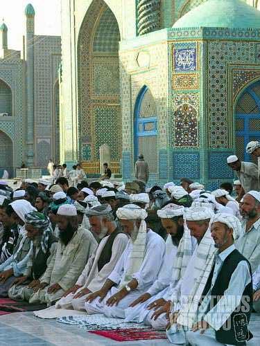 Pilgrims offer prayers in the shrine area