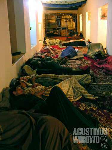 Travellers (musafirs) sleeping on the floor of restaurant along the central route of Afghanistan. The restaurants also serve as hotel for passengers. Along the isolated central route, the most common way of travelling is by hitchhiking a truck, like these