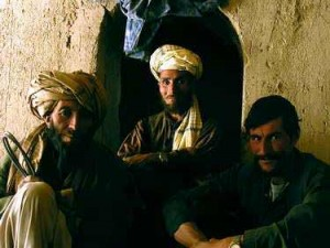 Three men in a mud house in Jar Sherwa, one of the poorest villages in the poor province of Ghour.