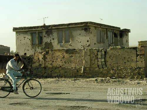 Bullet holes to remind you, this is a war-torn country