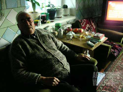 Yeja Kerim keeps up to date with Chinese Communist Party activities from the China Central Television (CCTV) in his house