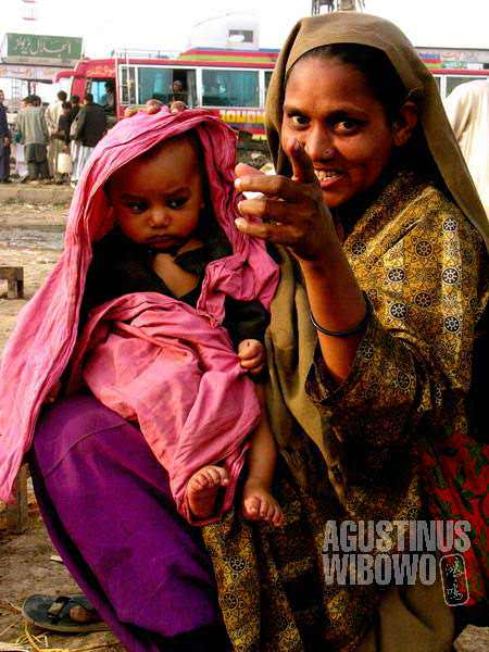 A woman beggar with her baby