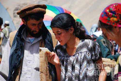 An Afghan man and a Tajik woman, in Ishkashim international bazaar