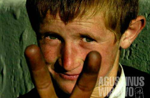 A Tajik boy from Tughoz, with blond hair and blue eyes. Many people here have European physical features.