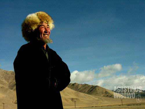 Kyrgyz man in Alichur, wearing the traditional furry hat and cloak, suitable for the harsh winter in the mountainous Pamir