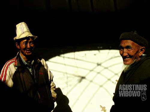 The Kyrgyz men in Murghab bazaar, with the hat they are proud of.